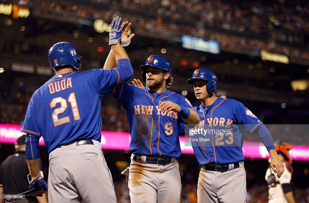 Kirk Nieuwenhuis #9 and Michael Cuddyer #23 of the New York Mets are congratulated by Lucas Duda #21 of the New York Mets after they both scored in the ninth inning against the San Francisco Giants at AT&T Park on July 6, 2015 in San Francisco, California.