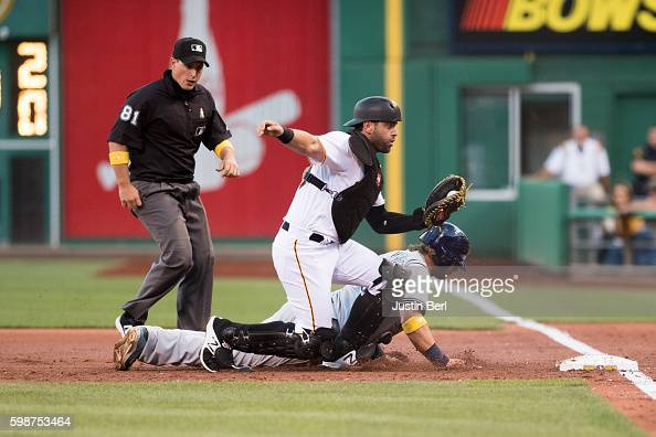 Kirk Nieuwenhuis of the Milwaukee Brewers is picked off by Francisco Cervelli of the Pittsburgh Pirates after being caught in a rundown as he...