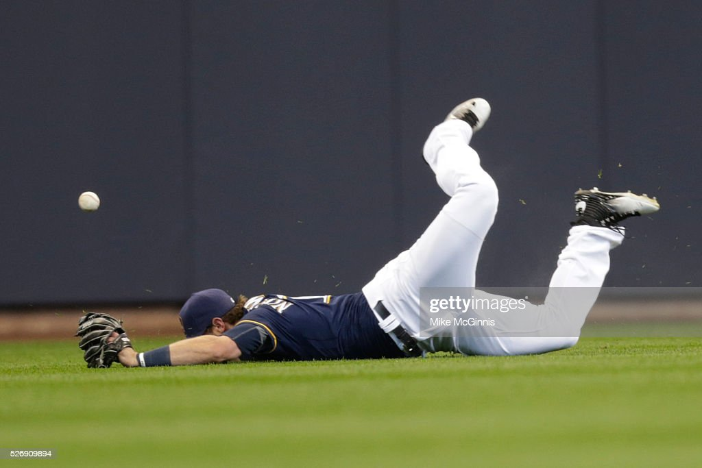 <a gi-track='captionPersonalityLinkClicked' href=/galleries/search?phrase=Kirk+Nieuwenhuis&family=editorial&specificpeople=6795708 ng-click='$event.stopPropagation()'>Kirk Nieuwenhuis</a> #10 of the Milwaukee Brewers misses the catch in catch awarding Derek Dietrich of the Miami Marlins a hit in the first inning at Miller Park on May 01, 2016 in Milwaukee, Wisconsin.