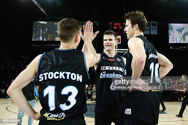 Kirk Penney of the Breakers high fives with teammate David Stockton after winning the round 10 NBL match between the New Zealand Breakers and the...