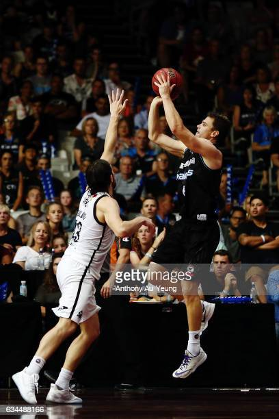 Kirk Penney of the Breakers shoots against Chris Goulding of United during the round 19 NBL match between the New Zealand Breakers and Melbourne...