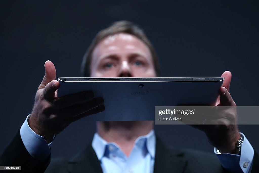 Kirk Skaugen, Intel Vice President, General Manager PC Client Group, holds a prototype of a new Fourth Generation Intel Ultrabook during an Intel press conference at the 2013 International CES at the Mandalay Bay Convention Center on January 7, 2013 in Las Vegas, Nevada. CES, the world's largest annual consumer technology trade show, runs from January 8-11 and is expected to feature 3,100 exhibitors showing off their latest products and services to about 150,000 attendees.