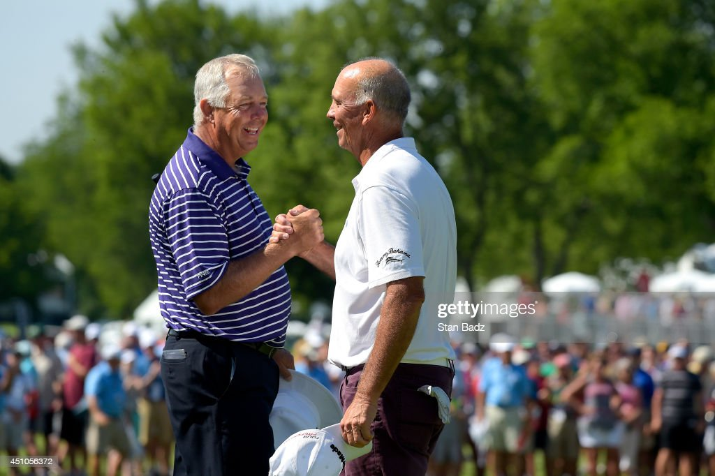 Kirk Triplett congratulates Tom Lehman on winning the Champions Tour Encompass Championship at North Shore Country Club on June 22 2014 in Glenview...