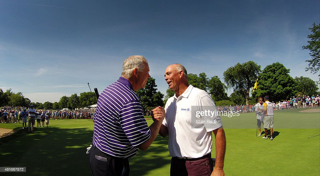 Kirk Triplett congratulates Tom Lehman on winning the Champions Tour's Encompass Championship at North Shore Country Club on June 22 2014 in Glenview...