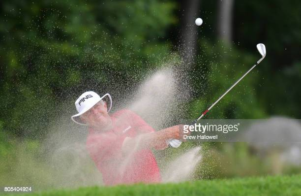 Kirk Triplett hits from the sand on the 14th hole during the third round of the 2017 US Senior Open Championship at Salem Country Club on July 1 2017...