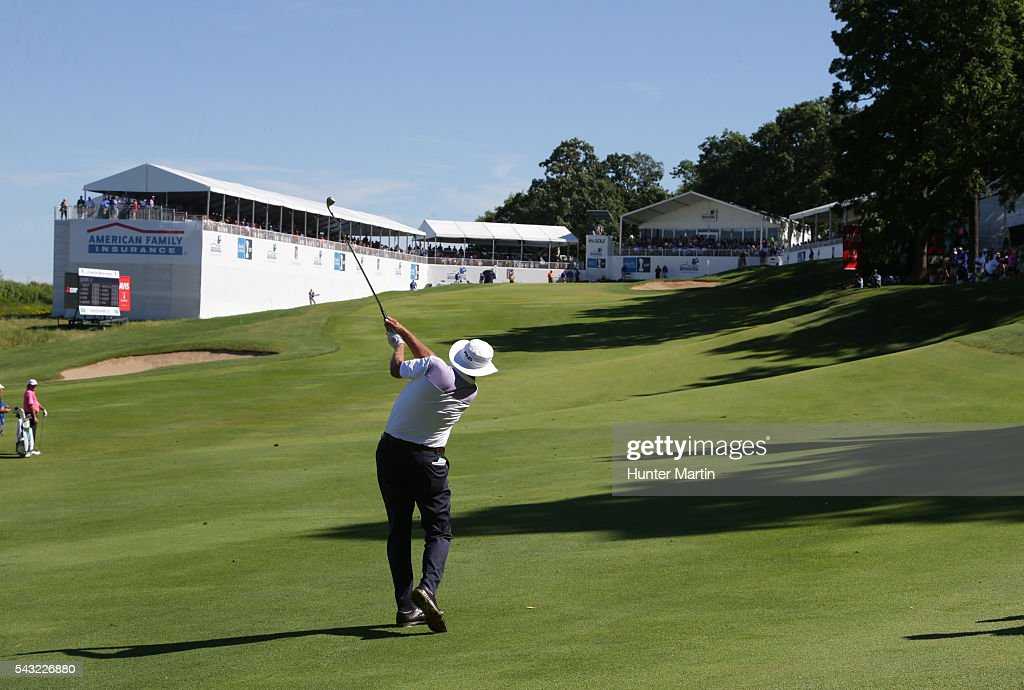 <a gi-track='captionPersonalityLinkClicked' href=/galleries/search?phrase=Kirk+Triplett&family=editorial&specificpeople=216443 ng-click='$event.stopPropagation()'>Kirk Triplett</a> hits his second shot on the 18th hole during the final round of the Champions Tour American Family Insurance Championship at University Ridge Golf Course on June 26, 2016 in Madison, Wisconsin.