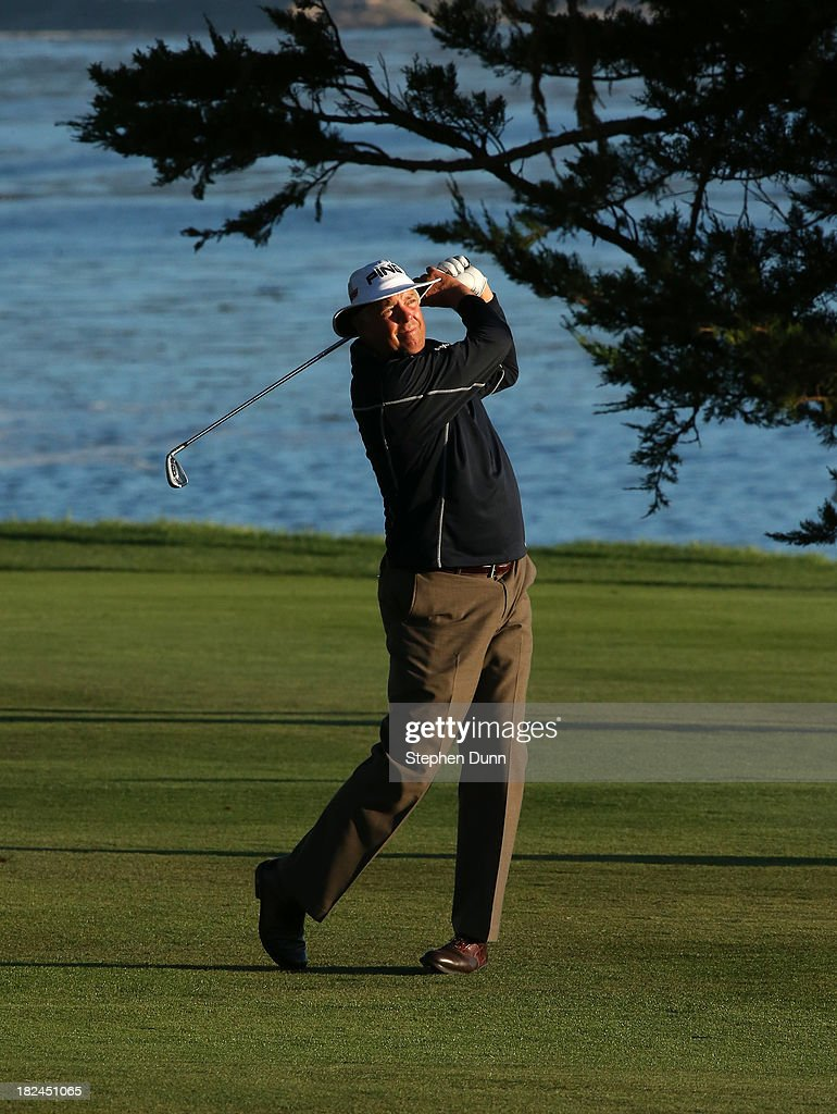 Kirk Triplett hits his second shot on the 18th hole durng the final round of the Nature Valley First Tee Open at Pebble Beach at Pebble Beach Golf Links on September 29, 2013 in Pebble Beach, California.