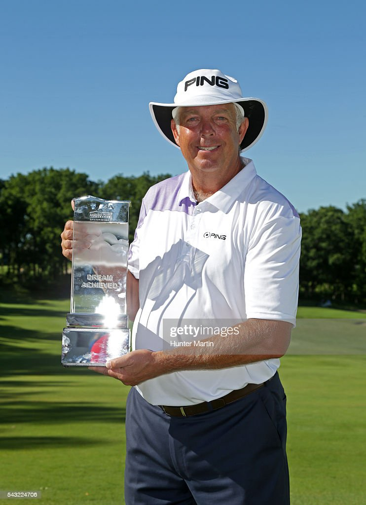 <a gi-track='captionPersonalityLinkClicked' href=/galleries/search?phrase=Kirk+Triplett&family=editorial&specificpeople=216443 ng-click='$event.stopPropagation()'>Kirk Triplett</a> holds the championship trophy after winning the Champions Tour American Family Insurance Championship at University Ridge Golf Course on June 26, 2016 in Madison, Wisconsin.