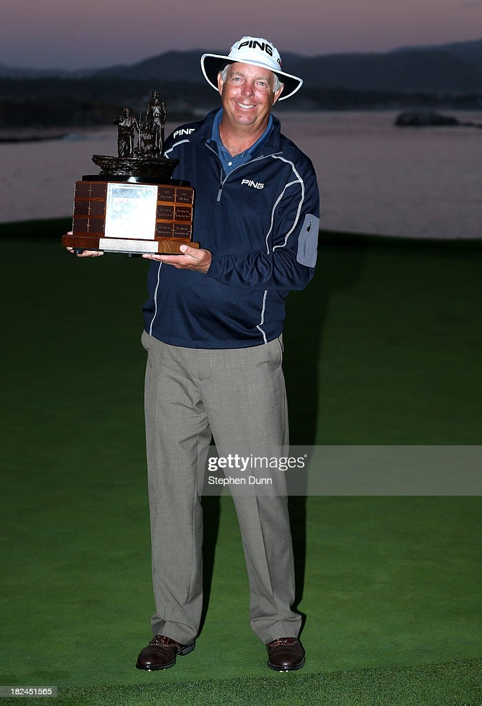 Kirk Triplett poses with the champions trophy after the final round of the Nature Valley First Tee Open at Pebble Beach at Pebble Beach Golf Links on September 29, 2013 in Pebble Beach, California.