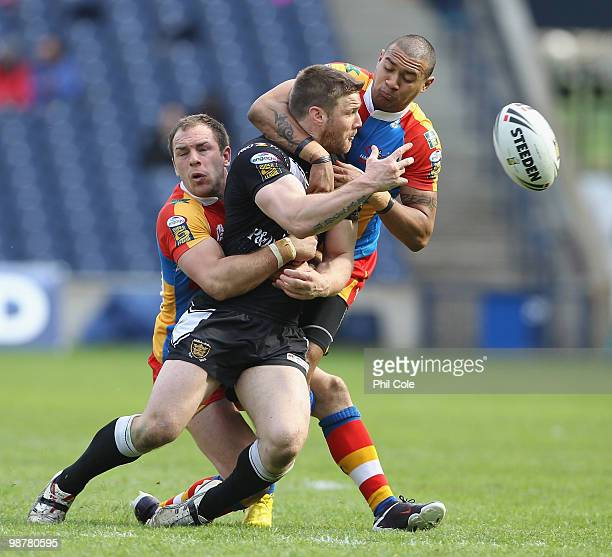 Kirk Yeaman of Hull FC is tackled by Luke Gale and Kevin Penny of Harlequins during the Engage Rugby Super League Magic Weekend match between Hull FC...