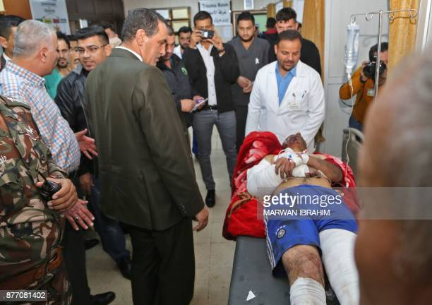 Kirkuk governor Rakan Said visits one of the victims of a suicide car bomb attack in the northern Iraqi town of Tuz Khurmatu near Iraq's oilrich...