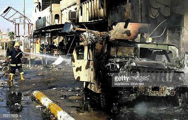 Iraqi firefighters douse fire that swept over an Iraqi army humvee at the site of a suicide car bombing in the northern Iraqi oil hub of Kirkuk 19...