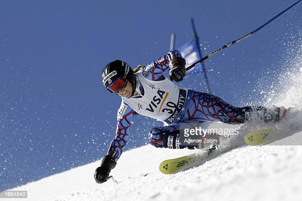 Kirsten Clark of the USA powers through a turn during the first run of the Women's World Cup Giant Slalom on November 21 2002 at Park City Ski Resort...