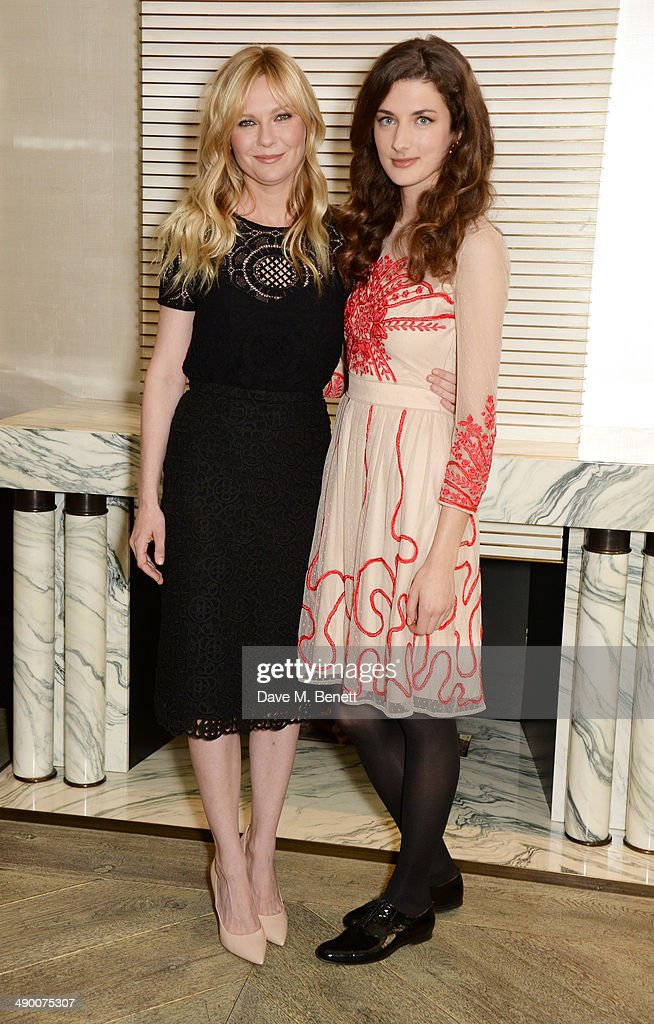 Kirsten Dunst and Daisy Bevan pose at a photocall for 'The Two Faces Of January' at Corinthia Hotel London on May 13 2014 in London England