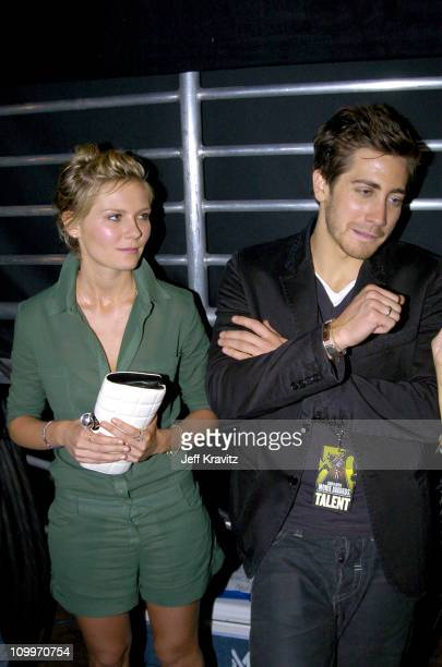 Kirsten Dunst and Jake Gyllenhaal during 2004 MTV Movie Awards Backstage and Audience at Sony Pictures Studios in Culver City California United States