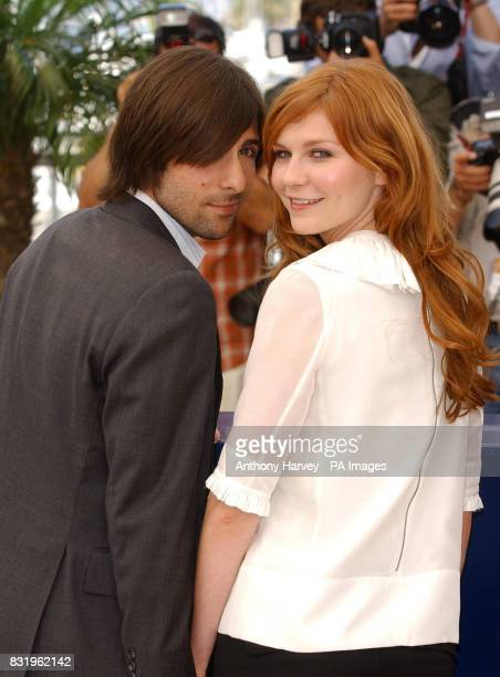 Kirsten Dunst and Jason Schwartzman pose for photographers during the photocall for Marie Antoinette in the Palais des Festival during the 59th...