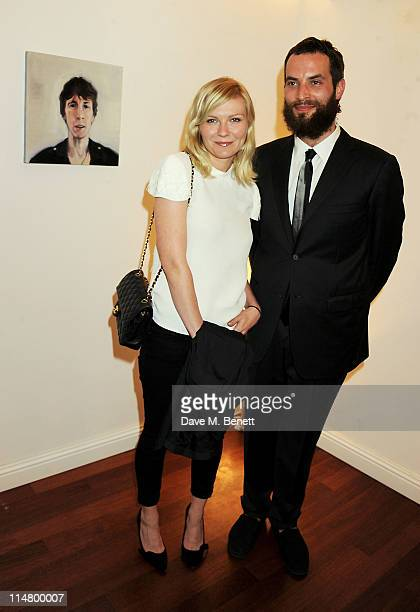 Kirsten Dunst and Sandro Kopp attend artist Sandro Kopp's exhibition for the Istancool Festival by Liberatum and Istanbul'74 on May 26 2011 in...
