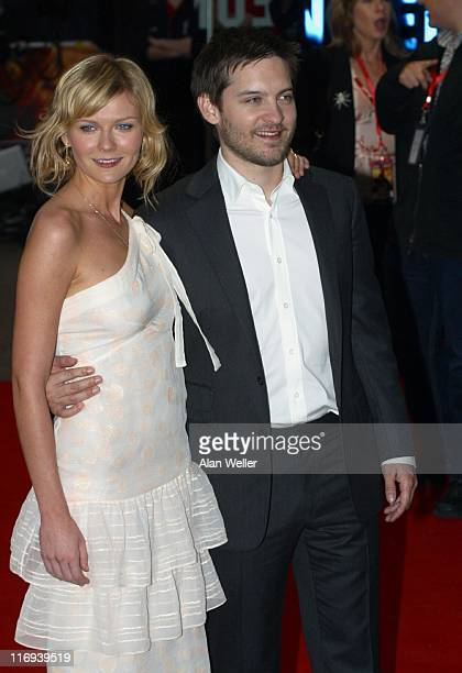 Kirsten Dunst and Tobey Maguire during 'SpiderMan 2' London Premiere Arrivals at Odeon Leicester Square in London England Great Britain