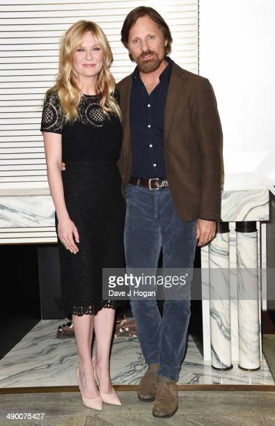 Kirsten Dunst and Viggo Mortensen attend a photocall for 'The Two Faces Of January' at The Corinthia Hotel on May 13 2014 in London England