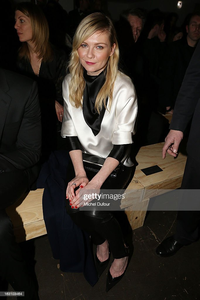 <a gi-track='captionPersonalityLinkClicked' href=/galleries/search?phrase=Kirsten+Dunst&family=editorial&specificpeople=171590 ng-click='$event.stopPropagation()'>Kirsten Dunst</a> attends the Saint Laurent Fall/Winter 2013 Ready-to-Wear show as part of Paris Fashion Week on March 4, 2013 in Paris, France.