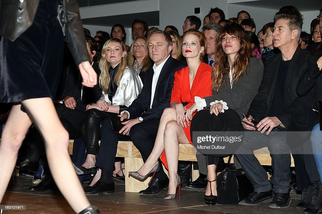 <Kirsten Dunst, Francois Pinault, <a gi-track='captionPersonalityLinkClicked' href=/galleries/search?phrase=Jessica+Chastain&family=editorial&specificpeople=653192 ng-click='$event.stopPropagation()'>Jessica Chastain</a>, Lou Doillon and Etienne Daho>attend the Saint Laurent Fall/Winter 2013 Ready-to-Wear show as part of Paris Fashion Week on March 4, 2013 in Paris, France.