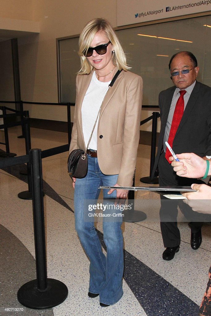 Kirsten Dunst is seen at LAX on October 14 2015 in Los Angeles California
