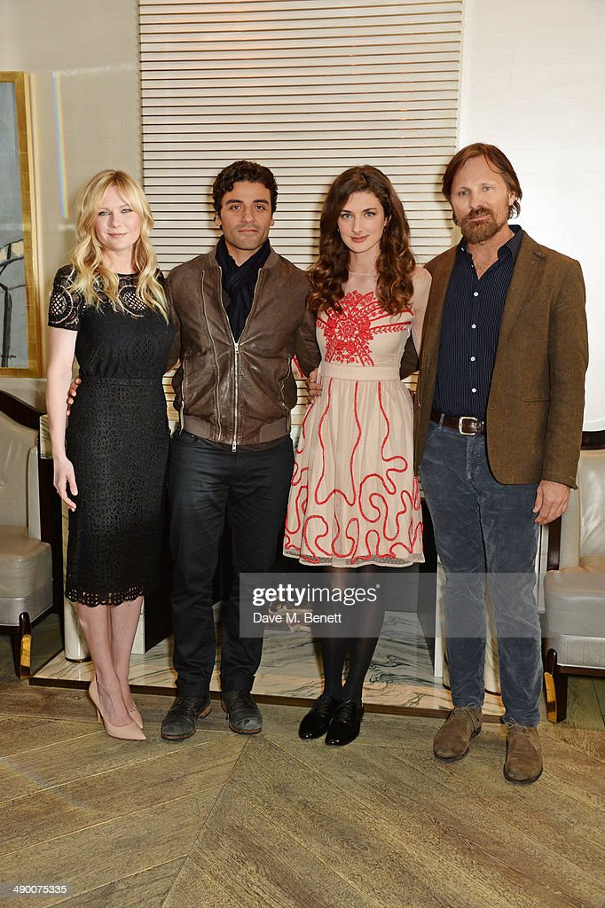 Kirsten Dunst Oscar Isaac Daisy Bevan and Viggo Mortensen poses at a photocall for 'The Two Faces Of January' at Corinthia Hotel London on May 13...