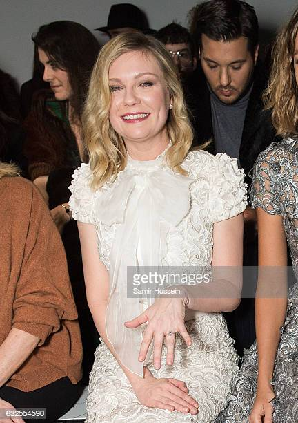 Kirsten Dunst shows her engagement ring as she attends the RalphRusso Haute Couture Spring Summer 2017 show as part of Paris Fashion Week on January...