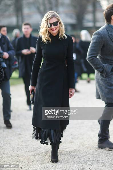 Kirsten Dunst wears sunglasses a black dress black shoes and attends the Christian Dior Haute Couture Spring Summer 2017 show as part of Paris...