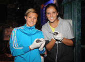 Kirsten Flipkens of Belgium and Laura Robson of Great Britain pose with Indian Spotted Turtles at the Sea Life Centre during The AEGON Classic Tennis...
