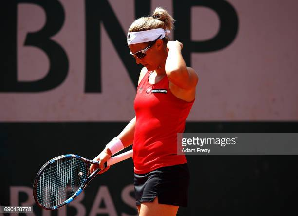 Kirsten Flipkens of Belgium hits a forehand during the second round match against Samantha Stosur of Australia on day four of the 2017 French Open at...