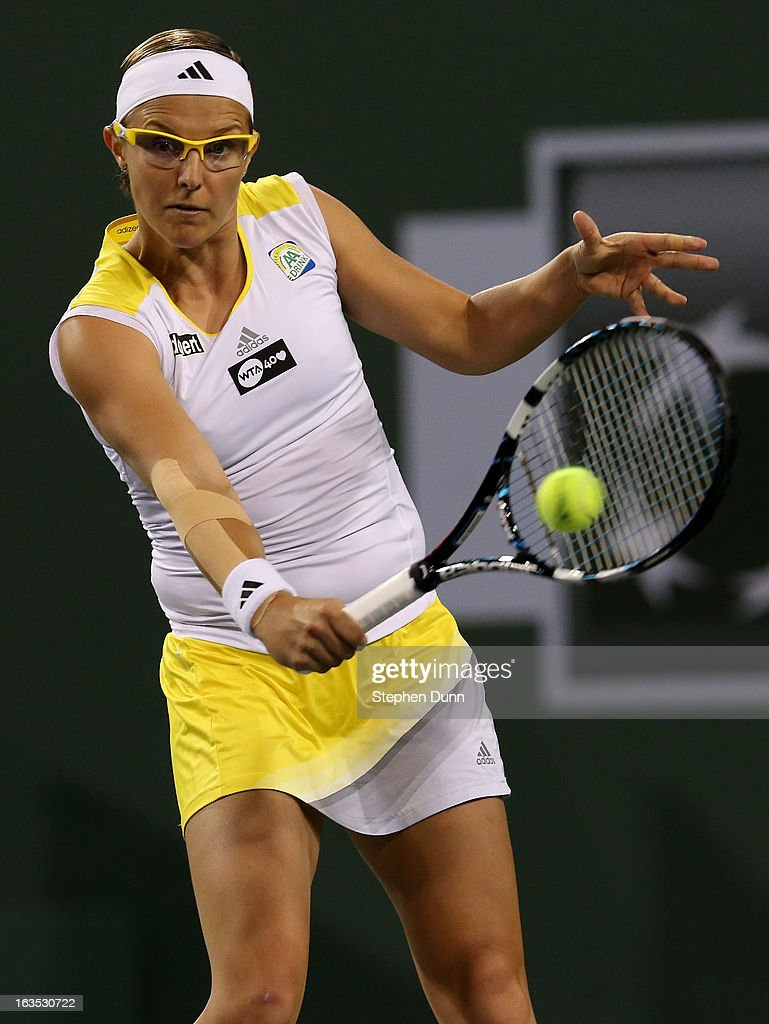 Kirsten Flipkens of Belgium hits a return to Victoria Azarenka of Belarus during day 6 of the BNP Paribas Open at Indian Wells Tennis Garden on March 11, 2013 in Indian Wells, California. (Photo by Stephen Dunn/Getty Images).