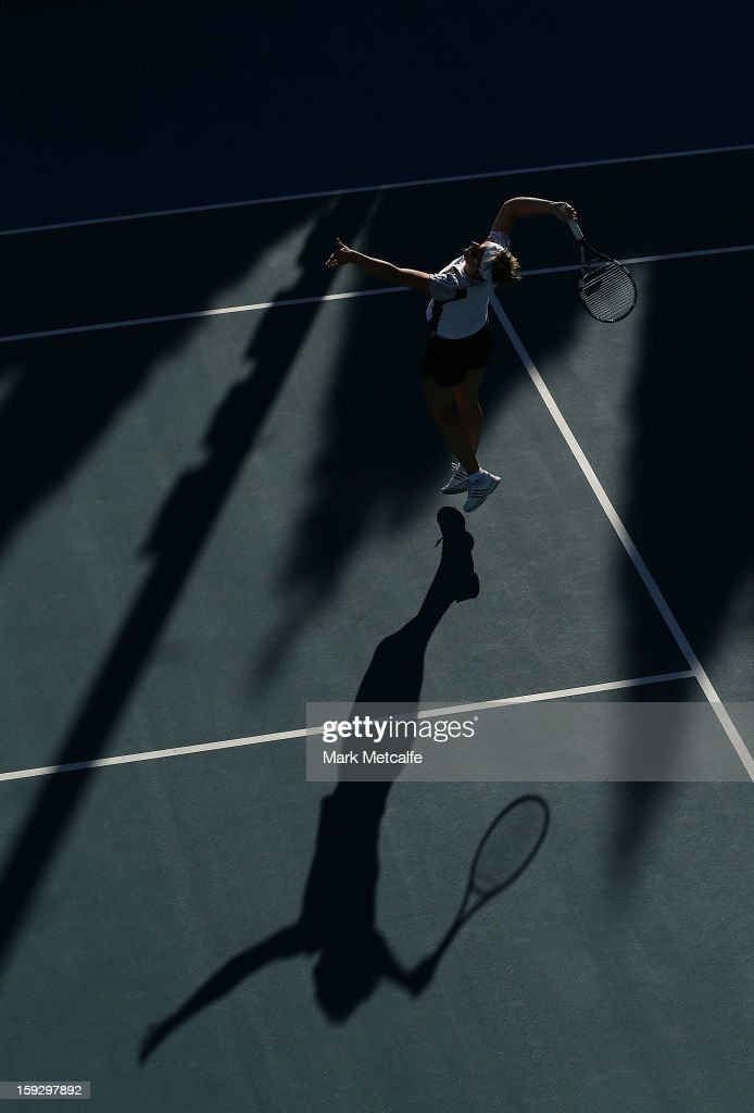 <a gi-track='captionPersonalityLinkClicked' href=/galleries/search?phrase=Kirsten+Flipkens&family=editorial&specificpeople=598749 ng-click='$event.stopPropagation()'>Kirsten Flipkens</a> of Belgium hits a smash in warm up before her semi final match against Mona Barthel of Germany during day eight of the Hobart International at Domain Tennis Centre on January 11, 2013 in Hobart, Australia.