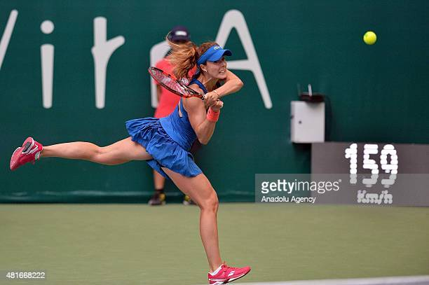 Kirsten Flipkens of Belgium in action against Alize Cornet of France during the TEB BNP Paribas Istanbul Cup tennis tournament at Koza World of...