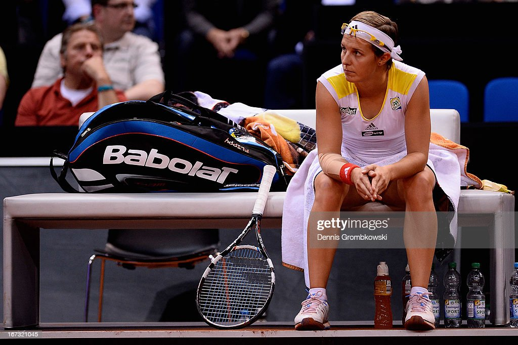 <a gi-track='captionPersonalityLinkClicked' href=/galleries/search?phrase=Kirsten+Flipkens&family=editorial&specificpeople=598749 ng-click='$event.stopPropagation()'>Kirsten Flipkens</a> of Belgium looks on during her match against Julia Goerges of Germany during Day 3 of the Porsche Tennis Grand Prix at Porsche-Arena on April 24, 2013 in Stuttgart, Germany.