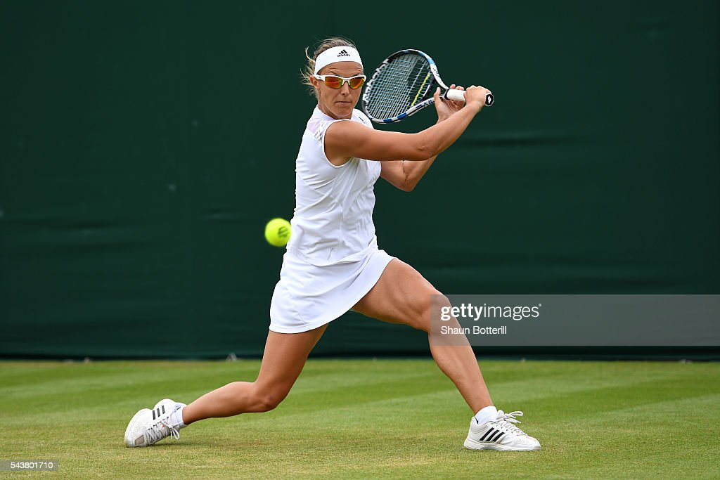 <a gi-track='captionPersonalityLinkClicked' href=/galleries/search?phrase=Kirsten+Flipkens&family=editorial&specificpeople=598749 ng-click='$event.stopPropagation()'>Kirsten Flipkens</a> of Belgium plays a backhand during the Ladies Singles second round match against Madison Keys of The United States on day four of the Wimbledon Lawn Tennis Championships at the All England Lawn Tennis and Croquet Club on June 30, 2016 in London, England.