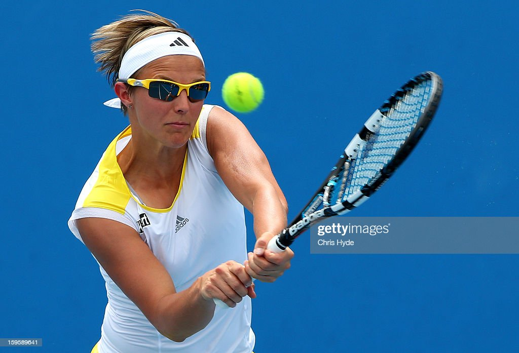 Kirsten Flipkens of Belgium plays a backhand in her first round doubles match with Magdalena Rybarikova of Slovakia against Raquel Kops-Jones of the United States and Abigail Spears of the United States during day four of the 2013 Australian Open at Melbourne Park on January 17, 2013 in Melbourne, Australia.