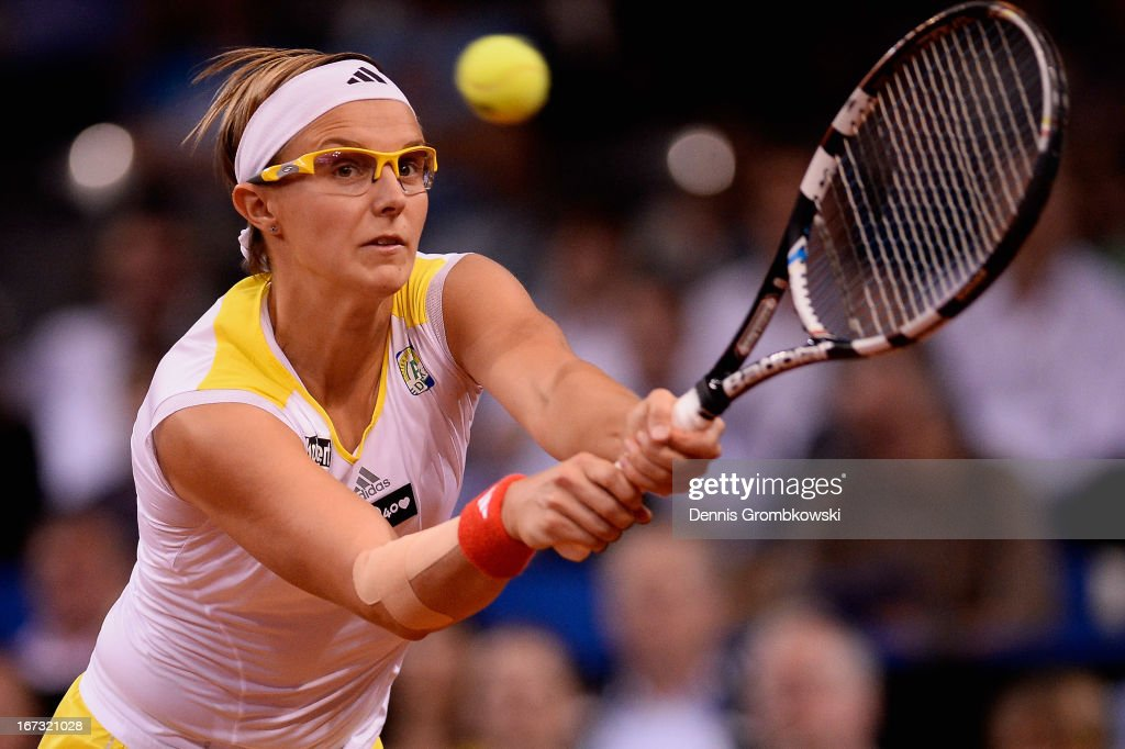 <a gi-track='captionPersonalityLinkClicked' href=/galleries/search?phrase=Kirsten+Flipkens&family=editorial&specificpeople=598749 ng-click='$event.stopPropagation()'>Kirsten Flipkens</a> of Belgium plays a backhand in her match against Julia Goerges of Germany during Day 3 of the Porsche Tennis Grand Prix at Porsche-Arena on April 24, 2013 in Stuttgart, Germany.