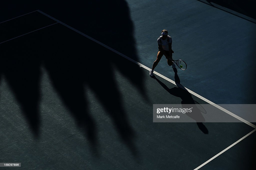 Kirsten Flipkens of Belgium plays a backhand in warm up before her semi final match against Mona Barthel of Germany during day eight of the Hobart International at Domain Tennis Centre on January 11, 2013 in Hobart, Australia.