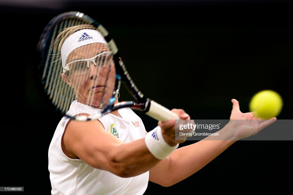 <a gi-track='captionPersonalityLinkClicked' href=/galleries/search?phrase=Kirsten+Flipkens&family=editorial&specificpeople=598749 ng-click='$event.stopPropagation()'>Kirsten Flipkens</a> of Belgium plays a forehand during the Ladies' Singles quarter-final match against Petra Kvitova of Czech Republic on day eight of the Wimbledon Lawn Tennis Championships at the All England Lawn Tennis and Croquet Club at Wimbledon on July 2, 2013 in London, England.