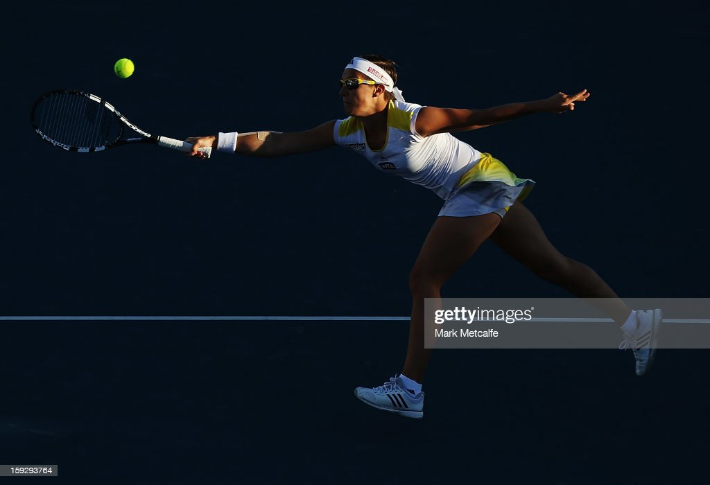<a gi-track='captionPersonalityLinkClicked' href=/galleries/search?phrase=Kirsten+Flipkens&family=editorial&specificpeople=598749 ng-click='$event.stopPropagation()'>Kirsten Flipkens</a> of Belgium plays a forehand volley in her semi final match against Mona Barthel of Germany during day eight of the Hobart International at Domain Tennis Centre on January 11, 2013 in Hobart, Australia.