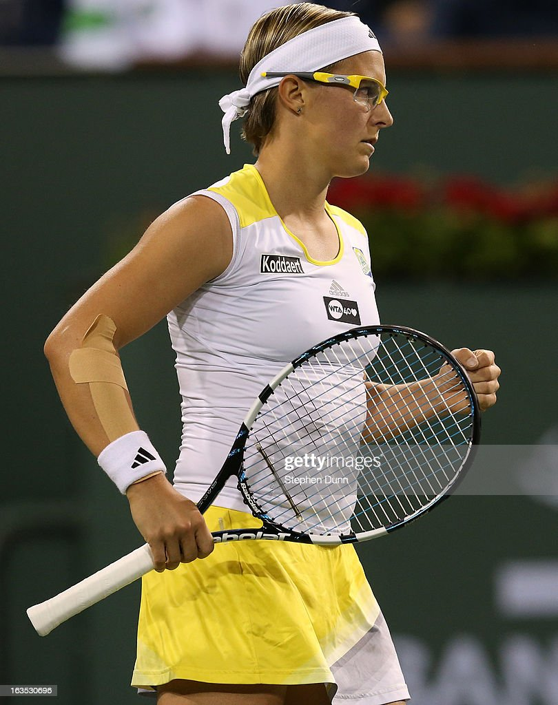Kirsten Flipkens of Belgium pumps her fist after winning the first set of her match with Victoria Azarenka of Belarus during day 6 of the BNP Paribas Open at Indian Wells Tennis Garden on March 11, 2013 in Indian Wells, California. (Photo by Stephen Dunn/Getty Images).