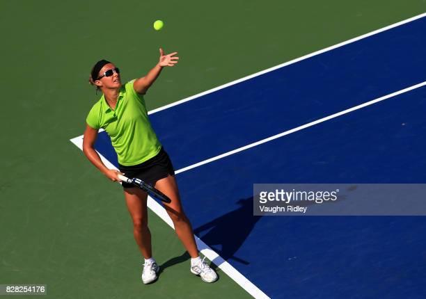 Kirsten Flipkens of Belgium serves against Garbine Muguruza of Spain during Day 5 of the Rogers Cup at Aviva Centre on August 9 2017 in Toronto Canada