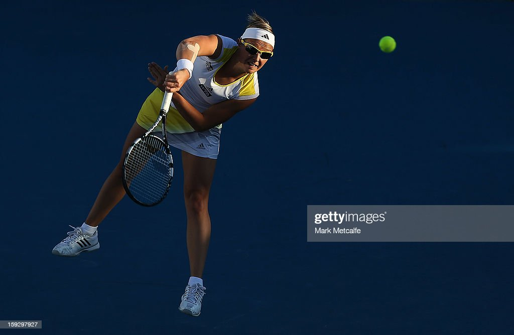 <a gi-track='captionPersonalityLinkClicked' href=/galleries/search?phrase=Kirsten+Flipkens&family=editorial&specificpeople=598749 ng-click='$event.stopPropagation()'>Kirsten Flipkens</a> of Belgium serves in her semi final match against Mona Barthel of Germany during day eight of the Hobart International at Domain Tennis Centre on January 11, 2013 in Hobart, Australia.
