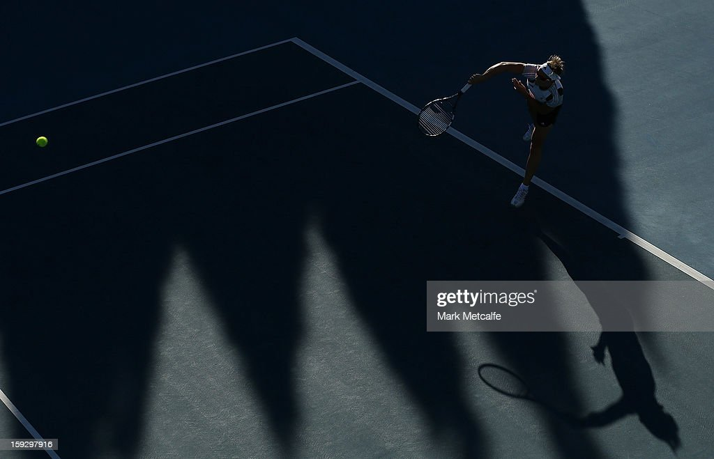 <a gi-track='captionPersonalityLinkClicked' href=/galleries/search?phrase=Kirsten+Flipkens&family=editorial&specificpeople=598749 ng-click='$event.stopPropagation()'>Kirsten Flipkens</a> of Belgium serves in warm up before her semi final match against Mona Barthel of Germany during day eight of the Hobart International at Domain Tennis Centre on January 11, 2013 in Hobart, Australia.