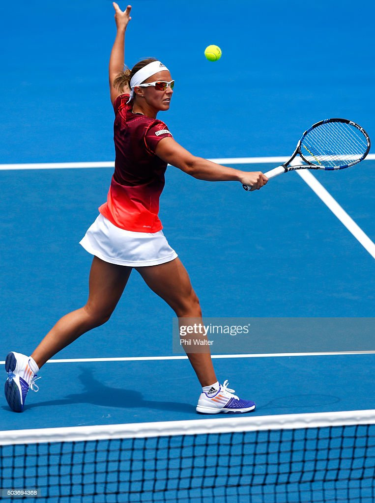 <a gi-track='captionPersonalityLinkClicked' href=/galleries/search?phrase=Kirsten+Flipkens&family=editorial&specificpeople=598749 ng-click='$event.stopPropagation()'>Kirsten Flipkens</a> of Belguim plays a backhand against Tamira Paszek of Austria during day four of the 2016 ASB Classic at ASB Tennis Arena on January 7, 2016 in Auckland, New Zealand.