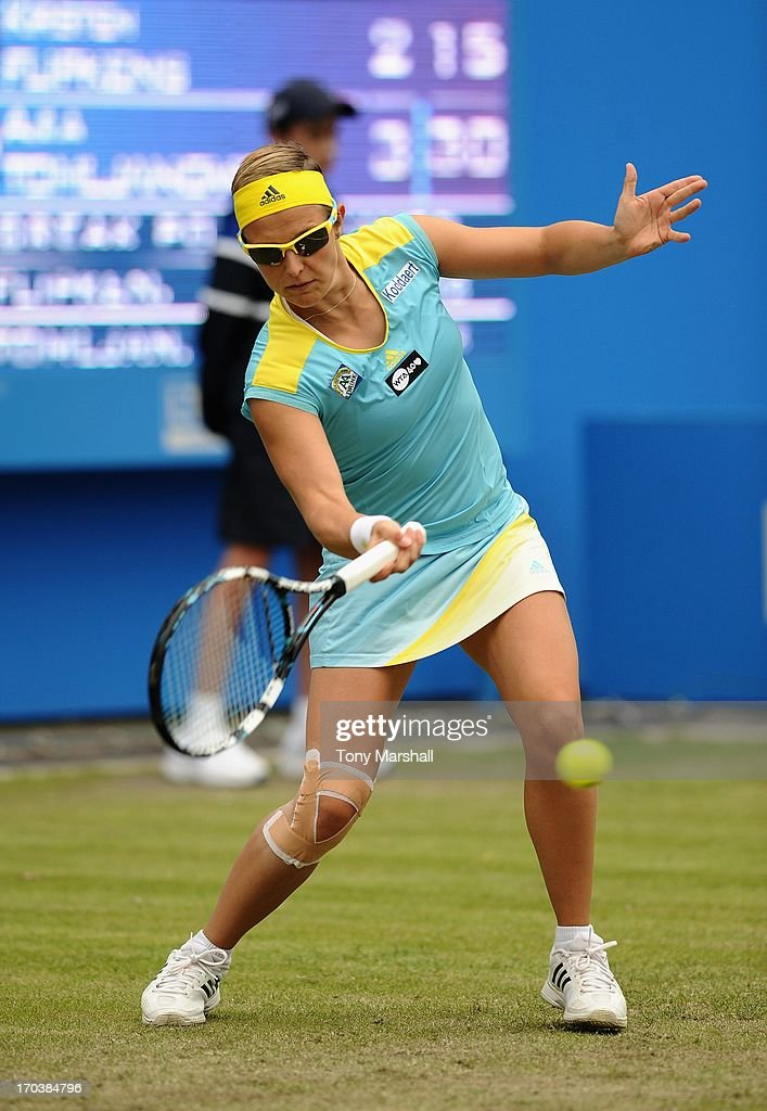 Kirsten Flipkens of Belguim returns a shot against Ajla Tomljanovic of Croatia during the AEGON Classic Tennis Tournament at Edgbaston Priory Club on June 12, 2013 in Birmingham, England.