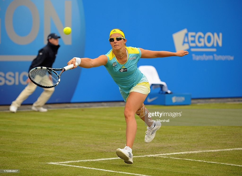 <a gi-track='captionPersonalityLinkClicked' href=/galleries/search?phrase=Kirsten+Flipkens&family=editorial&specificpeople=598749 ng-click='$event.stopPropagation()'>Kirsten Flipkens</a> of Belguim returns a shot against Ajla Tomljanovic of Croatia during the AEGON Classic Tennis Tournament at Edgbaston Priory Club on June 12, 2013 in Birmingham, England.