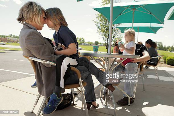 Kirsten Langhammer snuggles with her son Jacob during a family outing for shaved ice on May 5 2016 in O'Fallon Mo