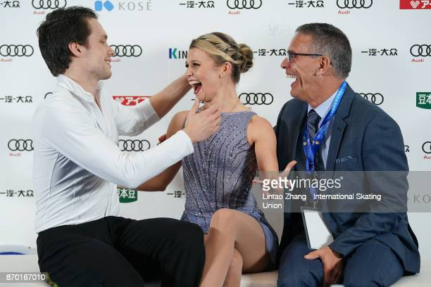 Kirsten MooreTowera and Michael Marinaro of Canada react after competing in the Pairs Free Skating on day two of Audi Cup of China ISU Grand Prix of...